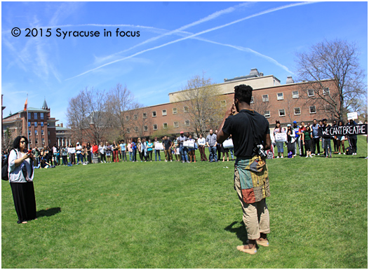 Journalist Sherri Williams (left) takes a video of Colton Jones during today's General Body demonstration (at Syracuse University).