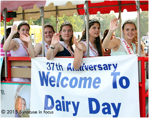 Dairy Princesses ride tram #12 during the daily parade.