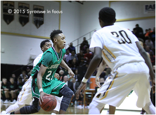 Bishop Ludden point guard Mika Adams-Woods sliced and diced the Henninger defense and orchestrated his team's 59-53 win on opening night of the Peppino's Invitational Tournament. Adams-Woods finished with 31 points.