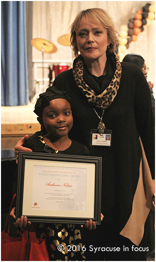 McKinley Brighton music teacher Luba Lesser (right) nominated her student Ariahanna Nickens for an Unsung Hero Award. They are pictured here at the District Martin Luther King, Jr. Celebration and awards program on Saturday.