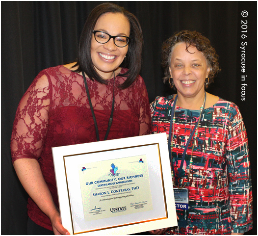 Sharon L. Contreras, PhD, (left) is the first female superindendent of the Syracuse City School District and first woman of color to serve in that position for one of New York States Big Five districts, was given a community leader award by Upstate Medical University today. She is joined here by Dr. Danielle Laraque-Arena. Arena became Upstate's seventh president last month.