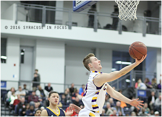 CBA senior Mark Lutz made a reverse layup in the first half of yesterday's Section III (Class A) final against. Notre Dame. Lutz led all scorers with 22 and CBA won 61-46.