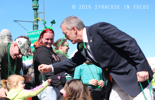 Rep. John Katko handed out beads at the St. Patrick's Day Parade in the home district on Saturday