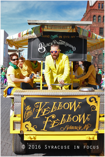 Mike Heagerty pilots the Little Yellow Fellow on S. Salina Street