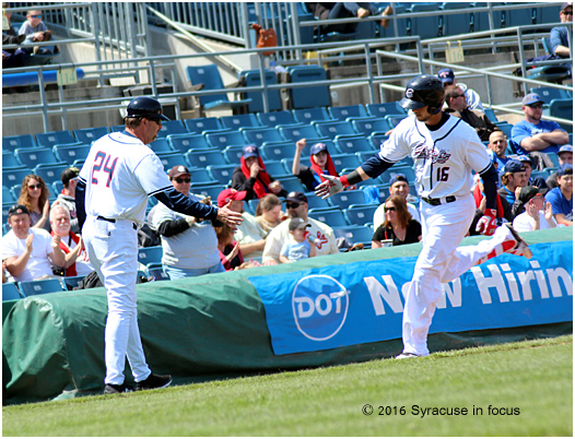 Skipper approved: Billy Gardner congratulates Skole as he rounds third base.