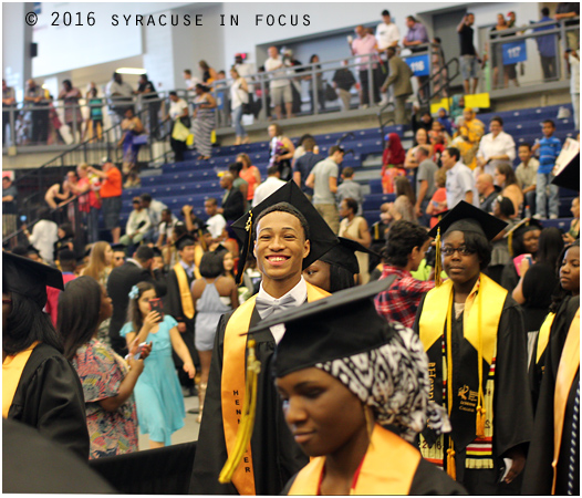 Henninger High Senior Taj Mitchell marches into SRC Arena with the Class of 2016.