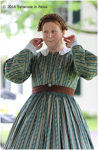 History and fashion expert Laini Amaritnant talked about ear bobs and bishop sleeves she was wearing during a vintage fashion show for the 24th Annual Peterboro Civil War Weekend on Saturday.