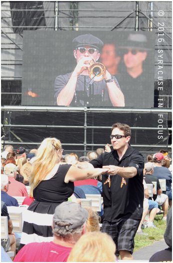 A couple dances to the fiesty jazz sounds of Big Bad Voodoo Daddy on the opening day of the New York State Fair.