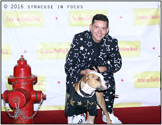Sarge the 2-year old pit bull mix and Justin the Sartorialist were show stoppers at the Syracuse Fashion Week Dressed to the K-9s runway show.