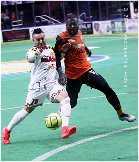 "Knigths player Jerjer Gibson (right) jockeys for position against Nelson ""Nelly"" Santana during  Thurday nights game against Baltimore. Nelly's return home was a good one for Baltimore, who beat the Silver Knights 6-3."