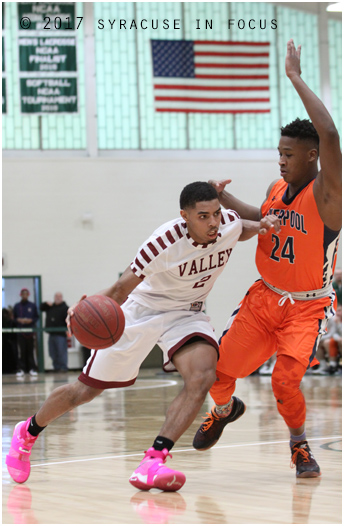 Corcoran's Jahaad Henry drove past Liverpool's Najheir Johnson for 2 of his 18 points in the third quarter, but Warriors wore down the Cougars and won 74-57.