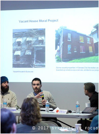 Liam Kirst of the Land Bank talked about a new mural program that will be applied to abandoned and dilapidated homes in the city. He was a guest, along with his father and Logan Reidsma, at the F.O.C.U.S. Forum.