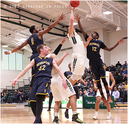 Stan the Man: Stan Buczek tips in one of his 17 points against Merrimack College. Lemoyne lost to Merrimack in the Regional Quarterfinals 72-68. Bucez also hit a key three pointer to send the game to overtime. He finished the game with 12 rebounds as well.