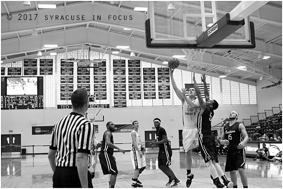 Junior forward Jack Jones sweeps up a sky hook during Sunday's game against Southern Connecticut. The College of St. Rose won the game 67-47,
