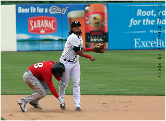 Emmanuel Burriss was active on his return to NBT Bank Stadium for the Chiefs. He led off the line up and played second base. Here he assists in a force out at second base in the top of the first inning.