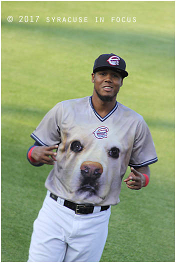 Even wearing a uniform with a dog face, third baseman Michael Almanzar still has style.